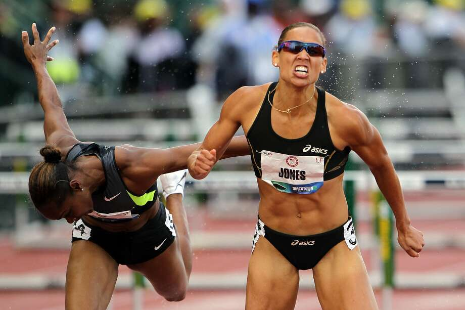 Michelle Perry and Lolo Jones compete in the women's 100-meter hurdles semi-final during Day Two of the 2012 U.S. Olympic Track & Field Team Trials at Hayward Field on June 23, 2012, in Eugene, Ore.  (Photo by Michael Heiman/Getty Images) (Michael Heiman / Getty Images)