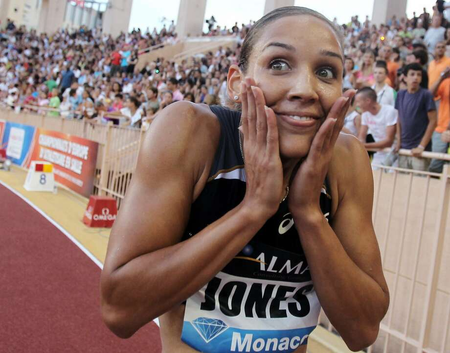 US Lolo Jones celebrates after winning the 100m hurdles contest of the IAAF Diamond League athletics meeting, on July 22, 2010, at the Louis II stadium in Monaco. (VALERY HACHE/AFP/Getty Images) (VALERY HACHE / AFP/Getty Images)