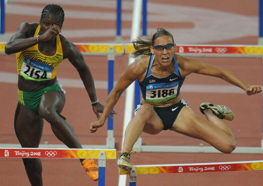 LoLo Jones misses a hurdle as she competes against Jamaica's Deloreen Ennis-London during the women's 100m  final at the National Stadium during the 2008 Beijing Olympic Games on Aug.19, 2008. Dawn Harper of the US won ahead of Australia's Sally McLellan and Canada's Priscilla Lopes-Schliep.    (JEWEL SAMAD/AFP/GettyImages) (AFP/Getty Images)
