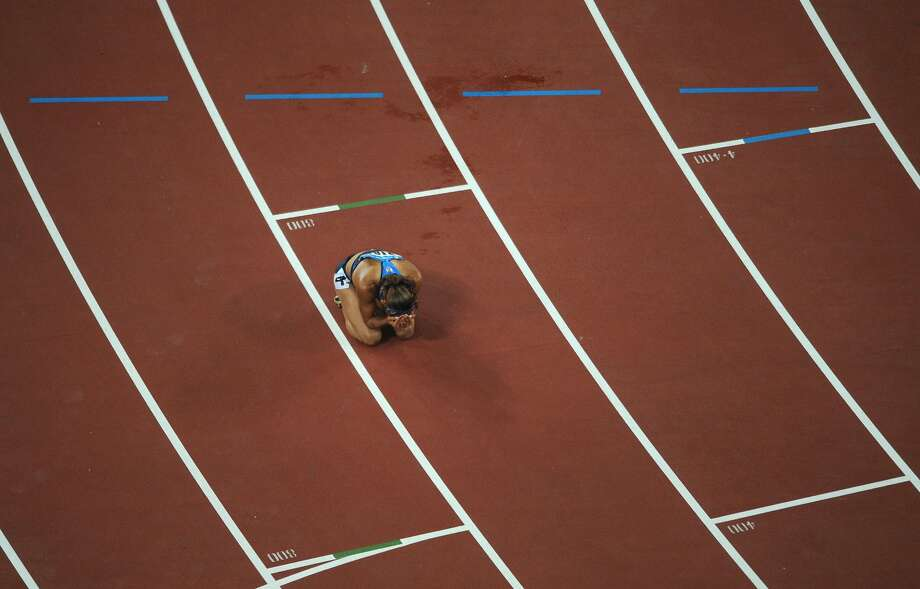 Lolo Jones  after losing the women's 100m hurdles final at the National Stadium during the 2008 Beijing Olympic Games on Aug. 19, 2008. Dawn Harper of the US won ahead of Australia's Sally McLellan and Canada's Priscilla Lopes-Schliep. (CHRISTOPHE SIMON/AFP/Getty Images) (CHRISTOPHE SIMON / AFP/Getty Images)