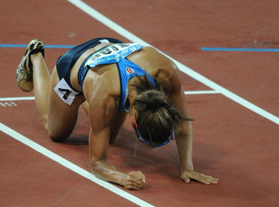 Lolo Jones of the US reacts after losing the women's 100m hurdles final at the National Stadium during the 2008 Beijing Olympic Games on Aug. 19, 2008. Dawn Harper of the US won ahead of Australia's Sally McLellan and Canada's Priscilla Lopes-Schliep.  (JEWEL SAMAD/AFP/Getty Images) (JEWEL SAMAD / AFP/Getty Images)