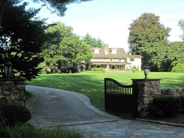 The residence at 1081 Ponus Ridge Road, New Canaan, shown above, was the scene of a home invasion Saturday, Aug. 4, 2012. Photo by Tyler Woods Photo: Contributed Photo