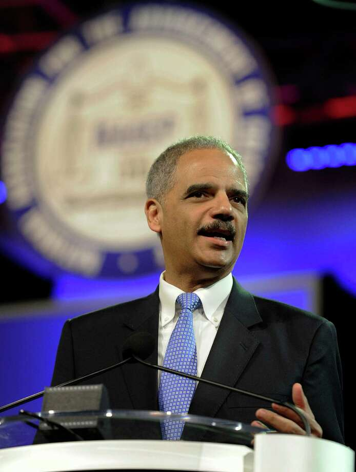 Attorney General Eric Holder speaks at the NAACP annual convention Tuesday, July 10, 2012, in Houston. Holder says he opposes a new photo ID requirement in Texas elections because it would be harmful to minority voters. (AP Photo/Pat Sullivan) Photo: Pat Sullivan, Associated Press / AP