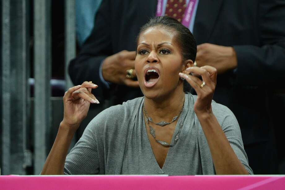First Lady Michelle Obama of the United States watches the Men's Basketball game between the United States and France on Day 2 of the London 2012 Olympic Games at Basketball Arena on July 29, 2012 in London, England.  (Photo by Pascal Le Segretain/Getty Images) (Pascal Le Segretain / Getty Images)
