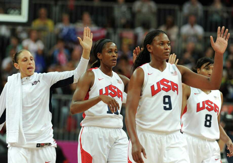 US players celebrate after winning the women's quarter final basketball match USA vs Canada at the London 2012 Olympic Games on August 7, 2012 at the North Greenwich arena in London. AFP PHOTO / MARK RALSTONMARK RALSTON/AFP/GettyImages Photo: MARK RALSTON, AFP/Getty Images / AFP