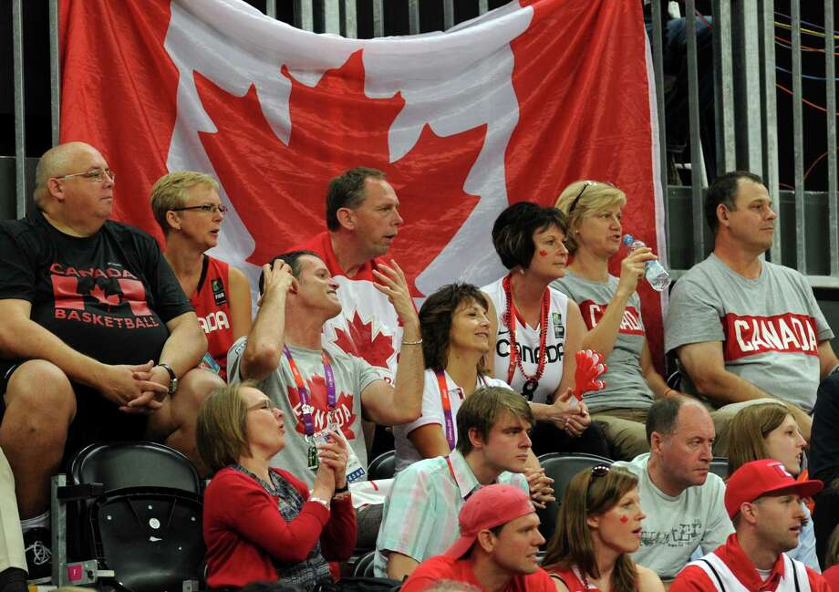 Canada fans react during the women's quarter final basketball match USA vs Canada at the London 2012 Olympic Games on August 7, 2012 at the North Greenwich arena in London. AFP PHOTO / MARK RALSTONMARK RALSTON/AFP/GettyImages Photo: MARK RALSTON, AFP/Getty Images / AFP