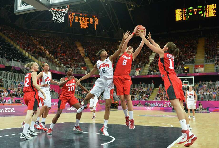 US gard Angel McCoughtry (8) vies with Canadian guard Shona Thorburn (6) during the women's quarter final basketball match USA vs Canada at the London 2012 Olympic Games on August 7, 2012 at the North Greenwich arena in London. AFP PHOTO / MARK RALSTONMARK RALSTON/AFP/GettyImages Photo: MARK RALSTON, AFP/Getty Images / AFP