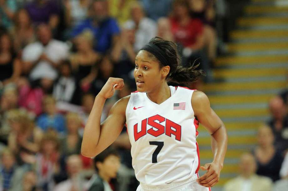 US guard Maya Moore reacts after scoring during the women's quarter final basketball match USA vs Canada at the London 2012 Olympic Games on August 7, 2012 at the North Greenwich arena in London. AFP PHOTO / MARK RALSTONMARK RALSTON/AFP/GettyImages Photo: MARK RALSTON, AFP/Getty Images / AFP