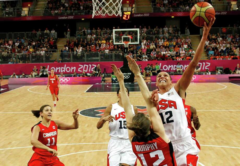 US' Diana Taurasi (12) shoots over Canada's Lizanne Murphy during the women's quarter final basketball match USA vs Canada at the London 2012 Olympic Games on August 7, 2012 at the North Greenwich arena in London.  AFP PHOTO / POOL /SERGIO PEREZSERGIO PEREZ/AFP/GettyImages Photo: SERGIO PEREZ, AFP/Getty Images / AFP