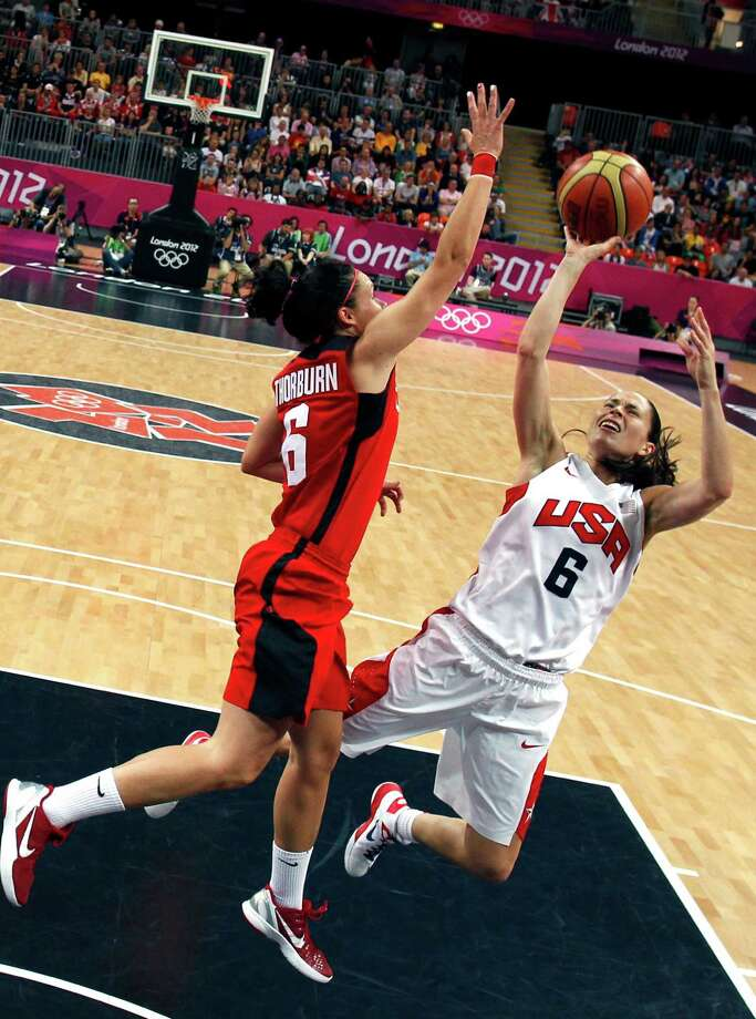 US' Sue Bird (R) shoots past Canada's Shona Thorburn during the women's quarter final basketball match USA vs Canada at the London 2012 Olympic Games on August 7, 2012 at the North Greenwich arena in London.  AFP PHOTO / POOL /SERGIO PEREZSERGIO PEREZ/AFP/GettyImages Photo: SERGIO PEREZ, AFP/Getty Images / AFP