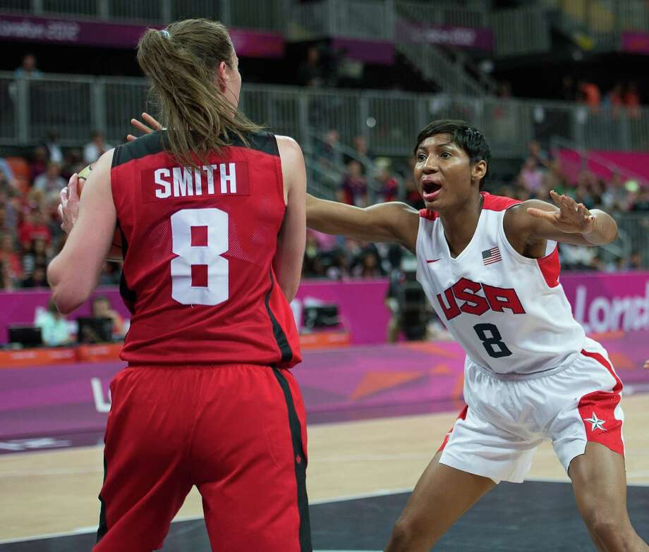 Canada's Kim Smith (8) tries to inbound the ball under the pressure of USA's Angel McCoughtry (8) during their quarterfinals game at the Basketball Arena at the Olympic Park during the 2012 Summer Olympic Games in London, England, Tuesday, August 7, 2012. USA defeated Canada 91-48. (Harry E. Walker/MCT) Photo: Harry E. Walker, McClatchy-Tribune News Service / Harry E. Walker, Copyright 2012