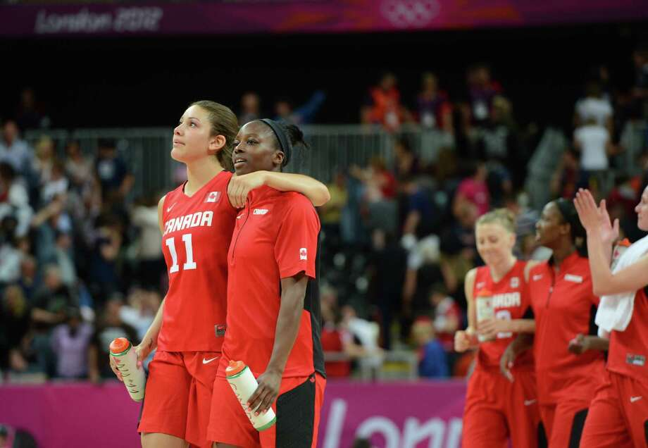 Canadian forward Natalie Achonwa (L) and team mates react after losing the women's quarter final basketball match USA vs Canada at the London 2012 Olympic Games on August 7, 2012 at the North Greenwich arena in London. AFP PHOTO / MARK RALSTONMARK RALSTON/AFP/GettyImages Photo: MARK RALSTON, AFP/Getty Images / AFP