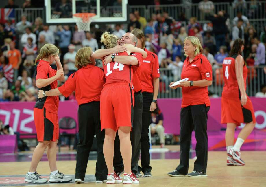 Canada's players react after losing the women's quarter final basketball match USA vs Canada at the London 2012 Olympic Games on August 7, 2012 at the North Greenwich arena in London. AFP PHOTO / MARK RALSTONMARK RALSTON/AFP/GettyImages Photo: MARK RALSTON, AFP/Getty Images / AFP
