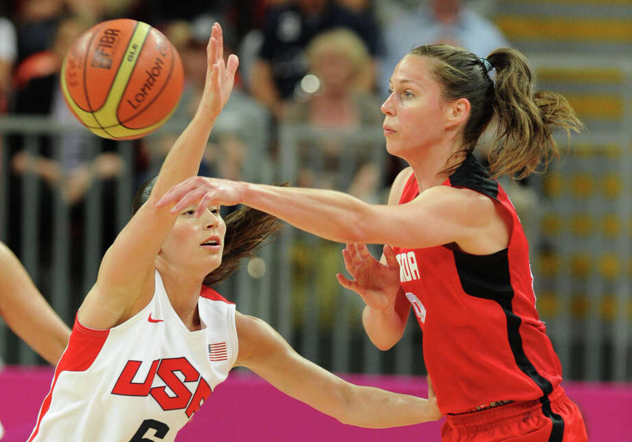 Canadian forward Miranda Ayim (R) vies with US guard Sue Bird during the women's quarter final basketball match USA vs Canada at the London 2012 Olympic Games on August 7, 2012 at the North Greenwich arena in London. AFP PHOTO / MARK RALSTONMARK RALSTON/AFP/GettyImages Photo: MARK RALSTON, AFP/Getty Images / AFP