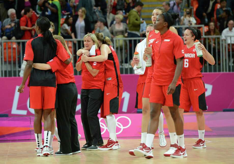 Canadian coach Allison McNeill and players react after losing the women's quarter final basketball match USA vs Canada at the London 2012 Olympic Games on August 7, 2012 at the North Greenwich arena in London. AFP PHOTO / MARK RALSTONMARK RALSTON/AFP/GettyImages Photo: MARK RALSTON, AFP/Getty Images / AFP