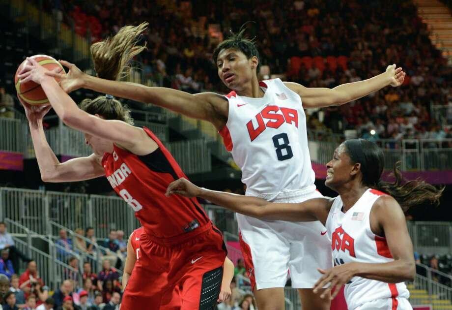 US gard Angel McCoughtry (R) vies with Canadian guard Kim Smith during the women's quarter final basketball match USA vs Canada at the London 2012 Olympic Games on August 7, 2012 at the North Greenwich arena in London. AFP PHOTO / MARK RALSTONMARK RALSTON/AFP/GettyImages Photo: MARK RALSTON, AFP/Getty Images / AFP