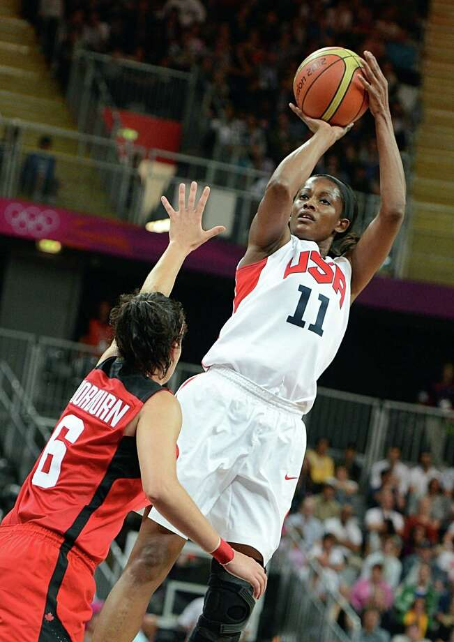 US forward Swin Cash (R) tries to score in front of Canadian guard Shona Thorburn during the women's quarter final basketball match USA vs Canada at the London 2012 Olympic Games on August 7, 2012 at the North Greenwich arena in London. AFP PHOTO / MARK RALSTONMARK RALSTON/AFP/GettyImages Photo: MARK RALSTON, AFP/Getty Images / AFP