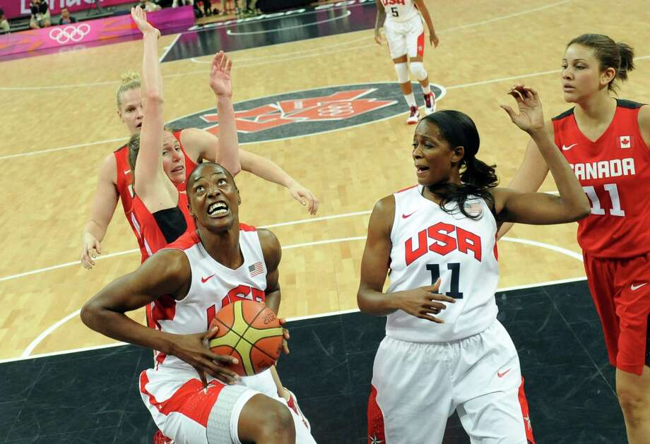US centre Sylvia Fowles (L) goes for a basket during the women's quarter final basketball match USA vs Canada at the London 2012 Olympic Games on August 7, 2012 at the North Greenwich arena in London.  AFP PHOTO / POOL / MARK RALSTONMARK RALSTON/AFP/GettyImages Photo: MARK RALSTON, AFP/Getty Images / AFP