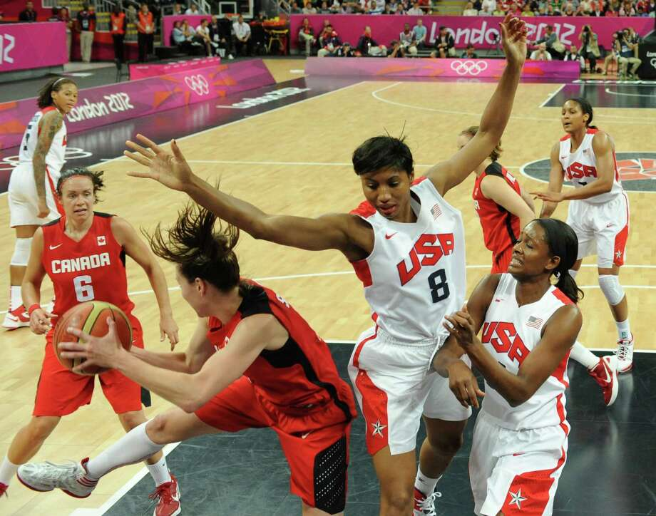 US gard Angel McCoughtry (C) vies with Canadian forward Lizanne Murphy during the women's quarter final basketball match USA vs Canada at the London 2012 Olympic Games on August 7, 2012 at the North Greenwich arena in London.  AFP PHOTO / POOL / MARK RALSTONMARK RALSTON/AFP/GettyImages Photo: MARK RALSTON, AFP/Getty Images / AFP