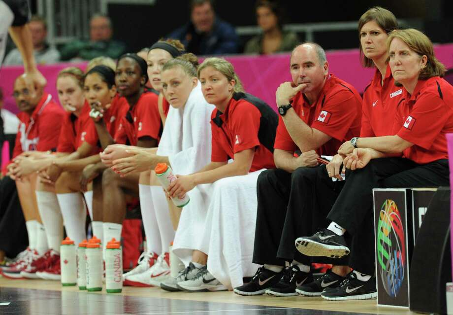 Canadian coach Allison McNeill (R) and players are pictured on the bench during the women's quarter final basketball match USA vs Canada at the London 2012 Olympic Games on August 7, 2012 at the North Greenwich arena in London. AFP PHOTO / MARK RALSTONMARK RALSTON/AFP/GettyImages Photo: MARK RALSTON, AFP/Getty Images / AFP