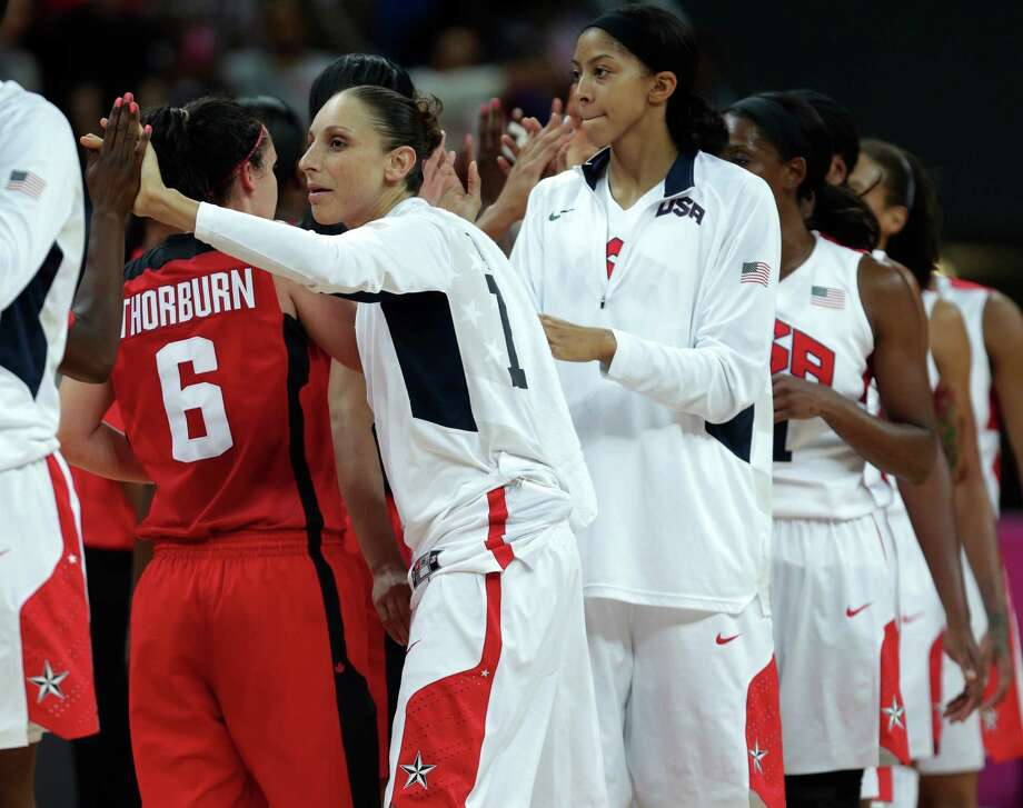 USA's Diana Taurasi and her teammates are congratulated by Canada after a women's basketball game at the 2012 Summer Olympics, Tuesday, Aug. 7, 2012, in London. USA beat Canada, eliminating them from competition. (AP Photo/Charles Krupa) Photo: Charles Krupa, Associated Press / AP
