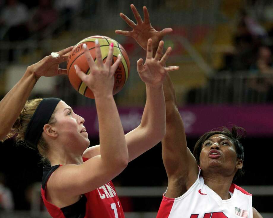 Canada's Michelle Plouffe has her shot blocked by USA's Angel McCoughtry, right, during a women's basketball game at the 2012 Summer Olympics, Tuesday, Aug. 7, 2012, in London. (AP) Photo/The Canadian Press, Frank Gunn) Photo: Frank Gunn, Associated Press / CP