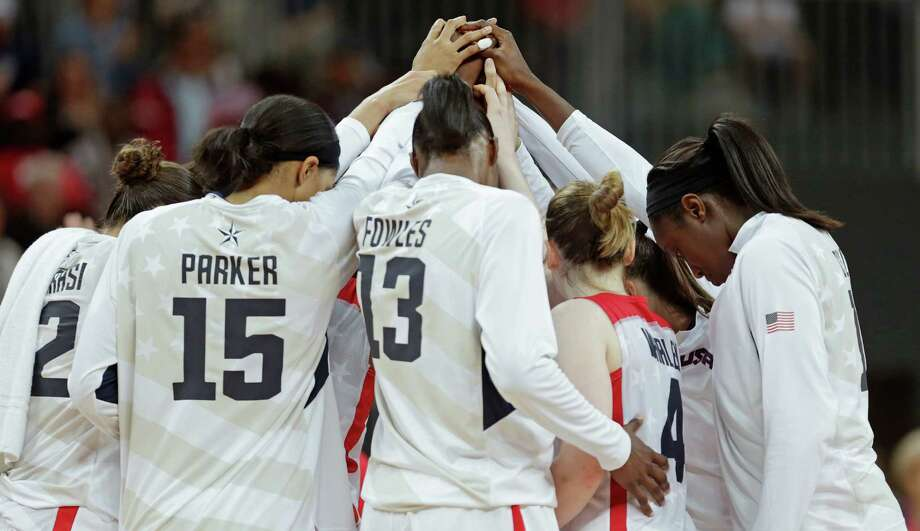 Team USA huddles together after eliminating Canada from the competition in a women's basketball game at the 2012 Summer Olympics, Tuesday, Aug. 7, 2012, in London. (AP Photo/Charles Krupa) Photo: Charles Krupa, Associated Press / AP