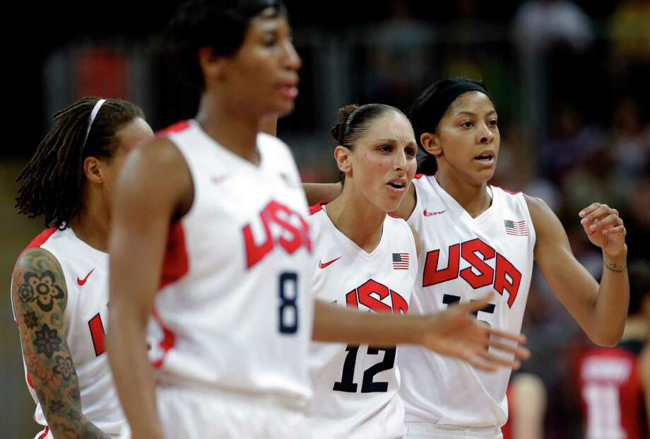 USA's Diana Taurasi (12) walks off the court with teammates USA's Seimone Augustus, left, Angel McCoughtry (8)and  Candace Parker, right, during a quarterfinal women's basketball game against Canada at the 2012 Summer Olympics, Tuesday, Aug. 7, 2012, in London. (AP Photo/Eric Gay) Photo: Eric Gay, Associated Press / AP