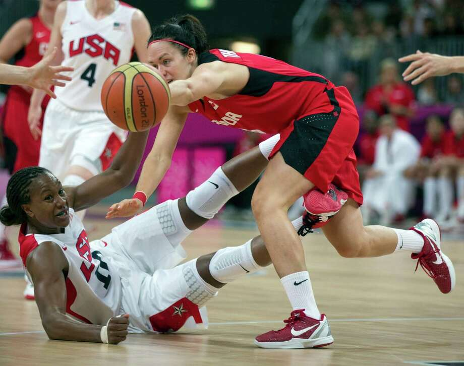 Canada's Shona Thorburn, right, and USA's Tamika Catchings, left,  battle for a loose ball during a women's basketball game at the 2012 Summer Olympics, Tuesday, Aug. 7, 2012, in London. (AP) Photo/The Canadian Press, Frank Gunn) Photo: Frank Gunn, Associated Press / CP