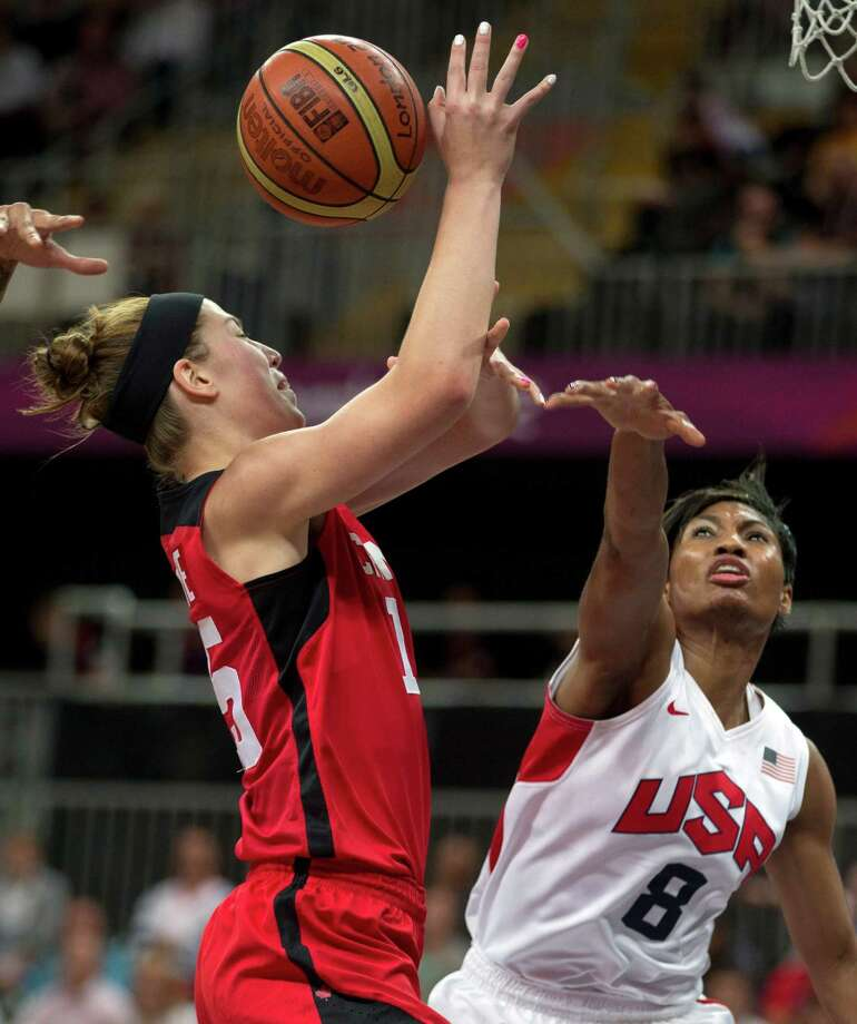 Canada's Michelle Plouffe, left,  has her shot blocked by USA's Angel McCoughtry (8) during a women's basketball game at the 2012 Summer Olympics, Tuesday, Aug. 7, 2012, in London. (AP) Photo/The Canadian Press, Frank Gunn) Photo: Frank Gunn, Associated Press / CP