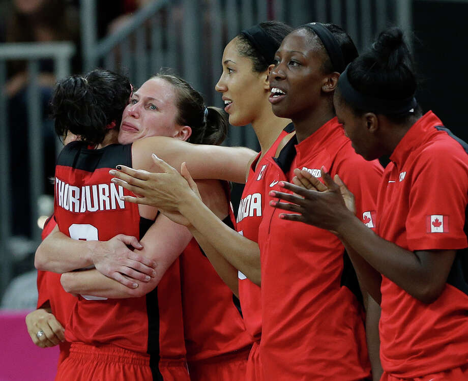 Canada's Shona Thorburn, left, hugs teammate Kim Smithduring  during the final moments of their quarterfinal women's basketball game against the USA at the 2012 Summer Olympics, Tuesday, Aug. 7, 2012, in London. (AP Photo/Eric Gay) Photo: Eric Gay, Associated Press / AP