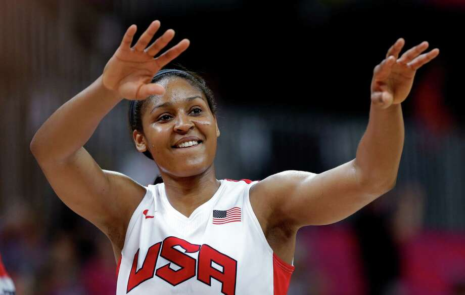 USA's Maya Moore celebrates after the team' win in a quarterfinal women's basketball game against Canada at the 2012 Summer Olympics, Tuesday, Aug. 7, 2012, in London. (AP Photo/Eric Gay) Photo: Eric Gay, Associated Press / AP