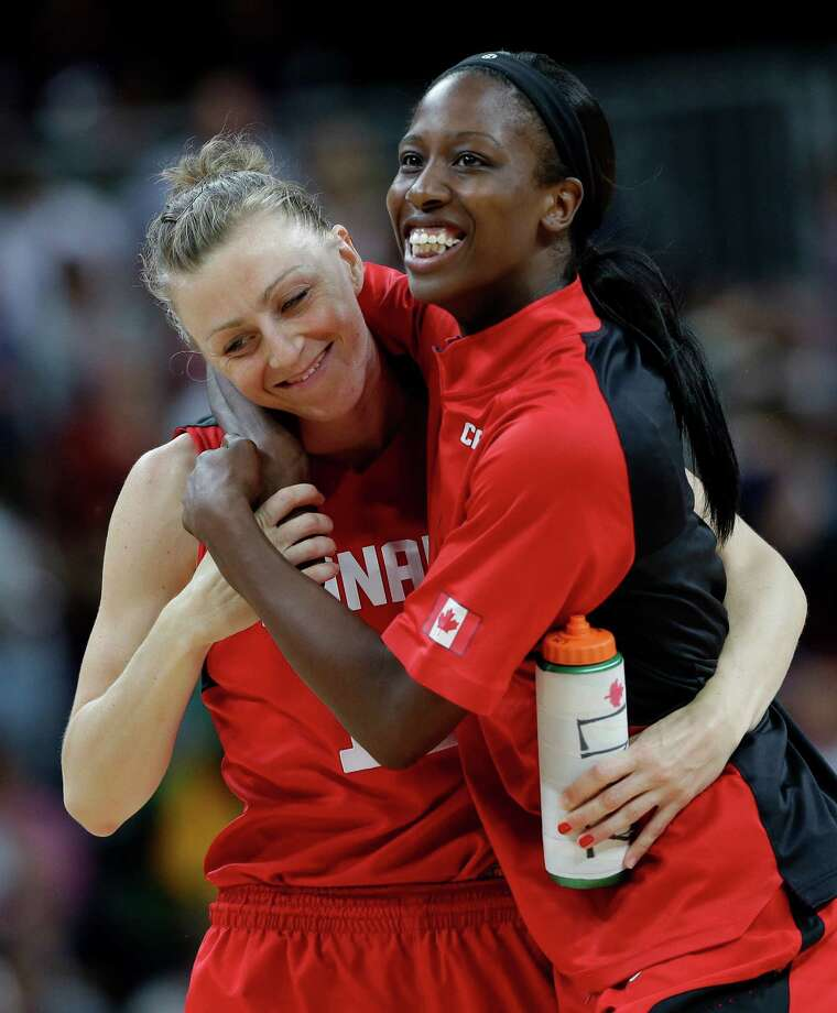 Canada's Lizanne Murphy, left, walks off the court with teammate Tamara Tatham, right, following their loss to the USA in a quarterfinal women's basketball game at the 2012 Summer Olympics, Tuesday, Aug. 7, 2012, in London. (AP Photo/Eric Gay) Photo: Eric Gay, Associated Press / AP