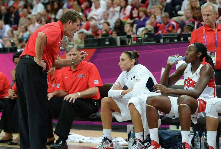 US coach Geno Auriemma talks to his players during the women's quarter final basketball match USA vs Canada at the London 2012 Olympic Games on August 7, 2012 at the basketball arena in London. AFP PHOTO / MARK RALSTONMARK RALSTON/AFP/GettyImages Photo: MARK RALSTON, AFP/Getty Images / AFP