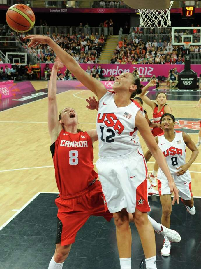 Canadian guard Kim Smith (L) vies with US guard Diana Taurasi during the women's quarter final basketball match USA vs Canada at the London 2012 Olympic Games on August 7, 2012 at the North Greenwich arena in London. AFP PHOTO / POOL / Mark RALSTONMARK RALSTON/AFP/GettyImages Photo: MARK RALSTON, AFP/Getty Images / AFP