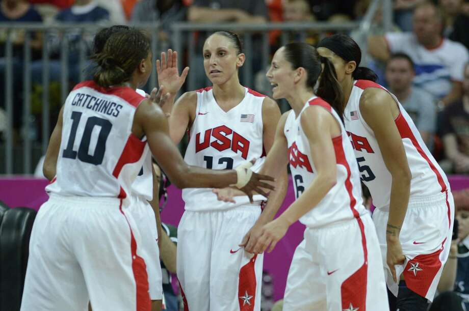 US' players celebrate during the women's quarter final basketball match USA vs Canada at the London 2012 Olympic Games on August 7, 2012 at the North Greenwich arena in London. AFP PHOTO / TIMOTHY A.  CLARYTIMOTHY A. CLARY/AFP/GettyImages Photo: TIMOTHY A. CLARY, AFP/Getty Images / AFP