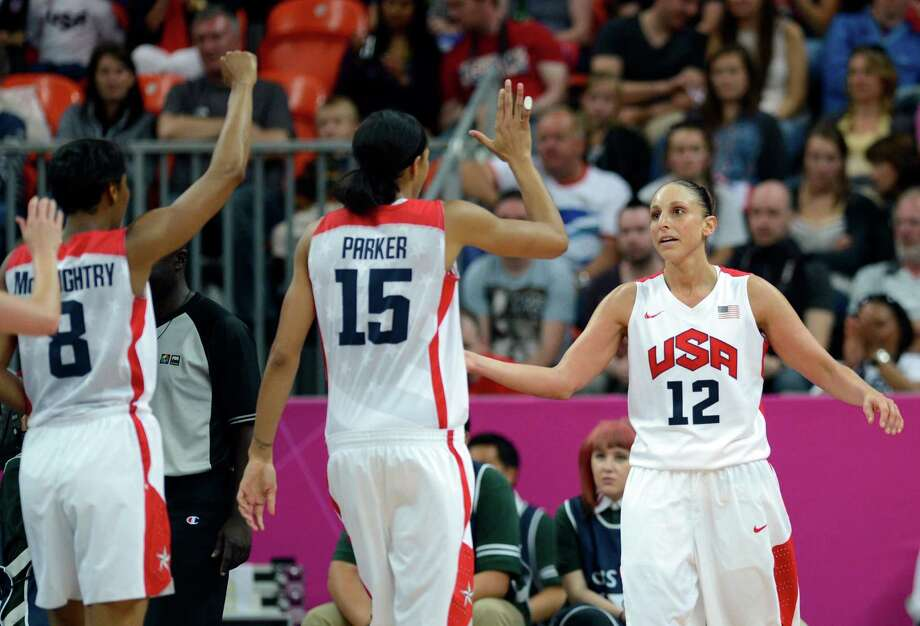US guard Diana Taurasi (R) celebrate with team mates during the women's quarter final basketball match USA vs Canada at the London 2012 Olympic Games on August 7, 2012 at the North Greenwich arena in London. AFP PHOTO / TIMOTHY A.  CLARYTIMOTHY A. CLARY/AFP/GettyImages Photo: TIMOTHY A. CLARY, AFP/Getty Images / AFP