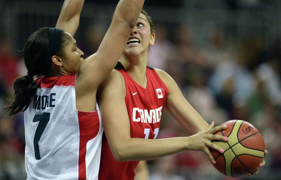 US guard Maya Moore (L) vies with Canadian forward Natalie Achonwa during the women's quarter final basketball match USA vs Canada at the London 2012 Olympic Games on August 7, 2012 at the North Greenwich arena in London. AFP PHOTO / TIMOTHY A.  CLARYTIMOTHY A. CLARY/AFP/GettyImages Photo: TIMOTHY A. CLARY, AFP/Getty Images / AFP