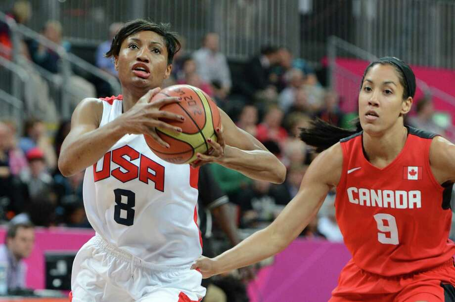 US gard Angel McCoughtry (L) vies with Canadian forward Miranda Ayim during the women's quarter final basketball match USA vs Canada at the London 2012 Olympic Games on August 7, 2012 at the North Greenwich arena in London. AFP PHOTO / MARK RALSTONMARK RALSTON/AFP/GettyImages Photo: MARK RALSTON, AFP/Getty Images / AFP