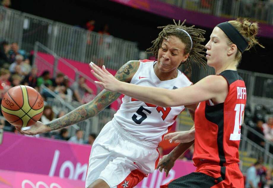 US guard Seimone Augustus (L) vies with Canadian forward Michelle Plouffe during the women's quarter final basketball match USA vs Canada at the London 2012 Olympic Games on August 7, 2012 at the North Greenwich arena in London. AFP PHOTO / MARK RALSTONMARK RALSTON/AFP/GettyImages Photo: MARK RALSTON, AFP/Getty Images / AFP