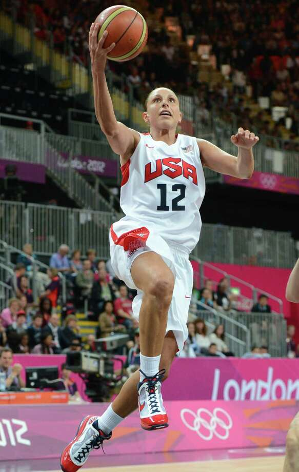 US guard Diana Taurasi goes in for a basket during the women's quarter final basketball match USA vs Canada at the London 2012 Olympic Games on August 7, 2012 at the North Greenwich arena in London. AFP PHOTO / MARK RALSTONMARK RALSTON/AFP/GettyImages Photo: MARK RALSTON, AFP/Getty Images / AFP
