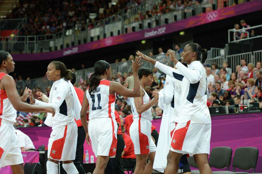 US' players cheer during the women's quarter final basketball match USA vs Canada at the London 2012 Olympic Games on August 7, 2012 at the North Greenwich arena in London. AFP PHOTO / MARK RALSTONMARK RALSTON/AFP/GettyImages Photo: MARK RALSTON, AFP/Getty Images / AFP