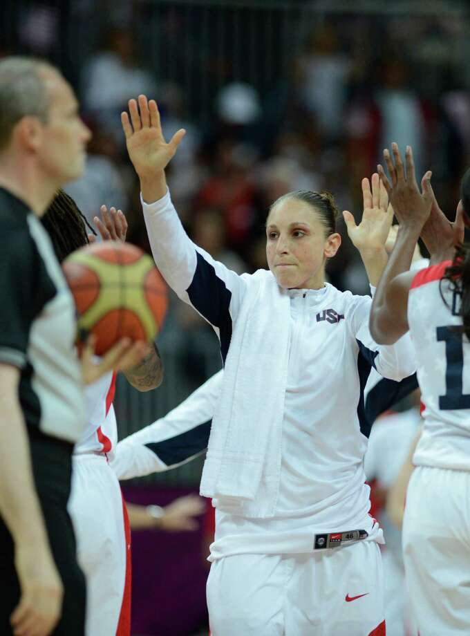 US guard Diana Taurasi and team mates celebrate after winning the women's quarter final basketball match USA vs Canada at the London 2012 Olympic Games on August 7, 2012 at the North Greenwich arena in London. AFP PHOTO / TIMOTHY A.  CLARYTIMOTHY A. CLARY/AFP/GettyImages Photo: TIMOTHY A. CLARY, AFP/Getty Images / AFP