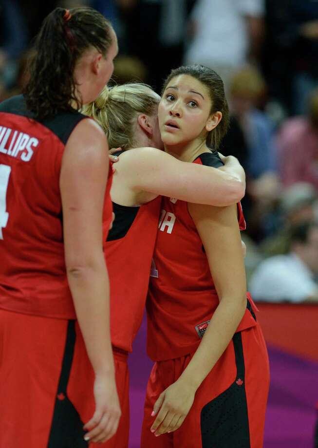 Canada's players react at the end of the women's quarter final basketball match USA vs Canada at the London 2012 Olympic Games on August 7, 2012 at the North Greenwich arena in London. AFP PHOTO / TIMOTHY A.  CLARYTIMOTHY A. CLARY/AFP/GettyImages Photo: TIMOTHY A. CLARY, AFP/Getty Images / AFP