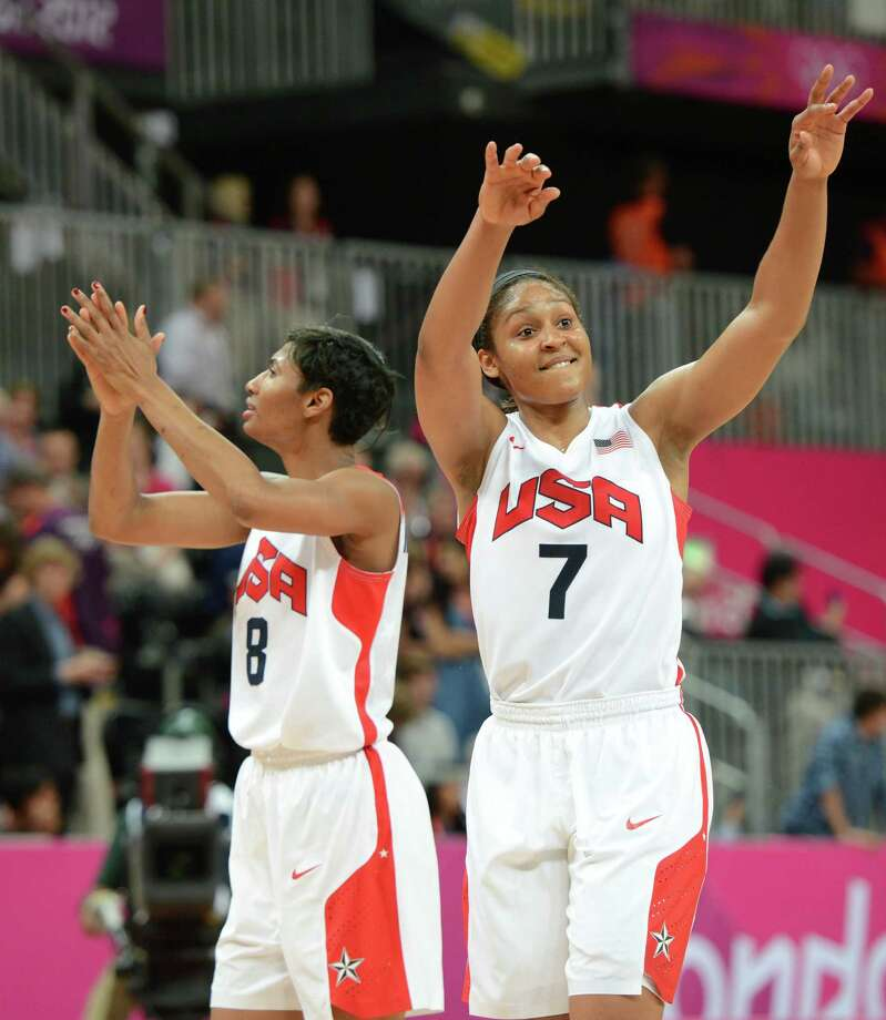 US guard Maya Moore (R) and US gard Angel McCoughtry celebrate after winning the women's quarter final basketball match USA vs Canada at the London 2012 Olympic Games on August 7, 2012 at the North Greenwich arena in London. AFP PHOTO / MARK RALSTONMARK RALSTON/AFP/GettyImages Photo: MARK RALSTON, AFP/Getty Images / AFP