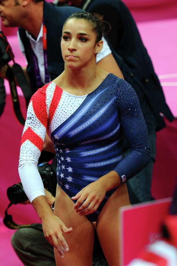 LONDON, ENGLAND - AUGUST 07:  Alexandra Raisman of the United States reacts after she competes on the beam during the Artistic Gymnastics Women's Beam final on Day 11 of the London 2012 Olympic Games at North Greenwich Arena on August 7, 2012 in London, England. Photo: Michael Regan, Getty Images / 2012 Getty Images