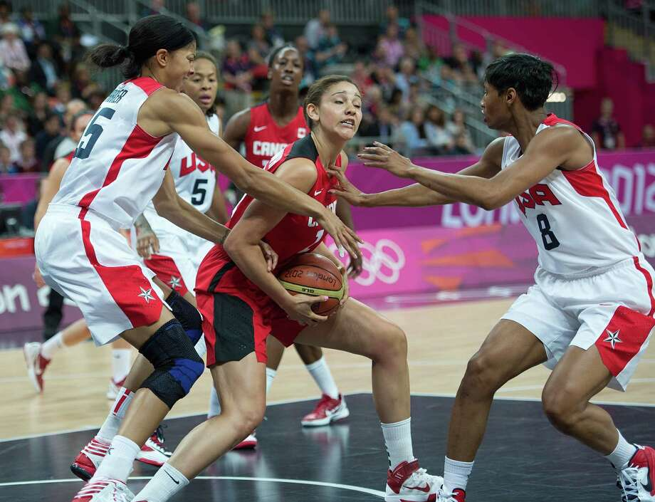 Candace Parker (left), Angel McCoughtry(right) and the U.S. swarmed Canada into 26 turnovers. Photo: Harry E. Walker, McClatchy-Tribune News Service / Harry E. Walker, Copyright 2012