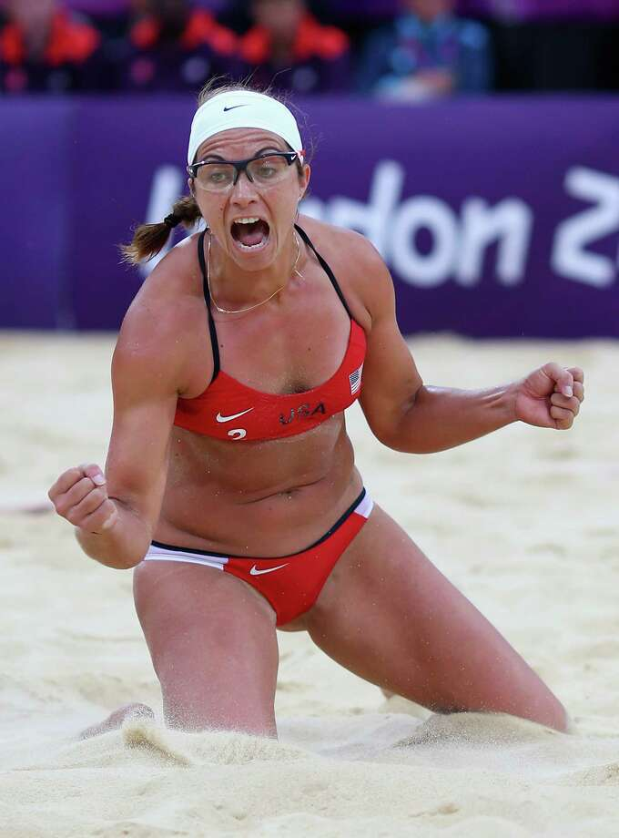 LONDON, ENGLAND - AUGUST 07:  Misty May-Treanor of the United States celebrates during the Women's Beach Volleyball Semi Final match between United States and China on Day 11 of the London 2012 Olympic Games at Horse Guards Parade August 7, 2012 in London, England. Photo: Ryan Pierse, Getty Images / 2012 Getty Images
