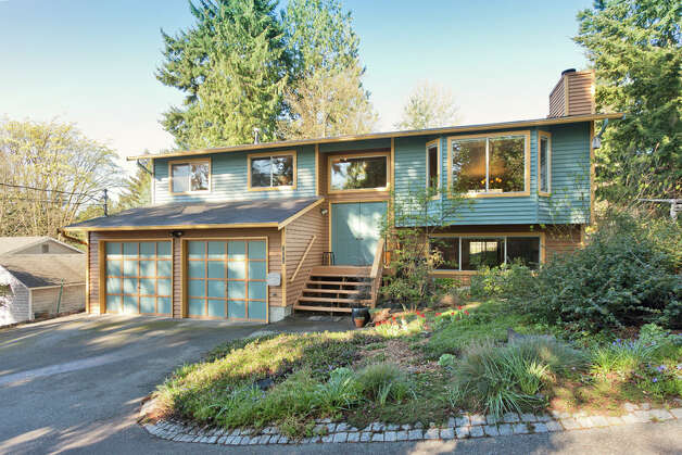 Lake City, in Northeast Seattle, offers a mix of homes at prices that are reasonable and on lots that are large, by Seattle standards. Here are four houses, each from a different decade, listed for less than $500,000, starting with the newest, 2712 N.E. 113th St. The 2,490-square-foot house, built in 1991, has four bedrooms, three bathrooms, vaulted ceilings, a family room with a gas stove, a deck and a garden on a 7,510-square-foot lot. It's listed for $475,000. Photo: Malia Campbell/Courtesy Cynthia Creasey/Lake & Co. Real Estate / (c) 2012 Malia Campbell Photography