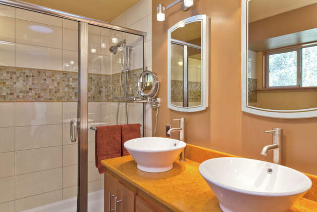 Bathroom of 2712 N.E. 113th St. The 2,490-square-foot house, built in 1991, has four bedrooms, three bathrooms, vaulted ceilings, a family room with a gas stove, a deck and a garden on a 7,510-square-foot lot. It's listed for $475,000. Photo: Malia Campbell/Courtesy Cynthia Creasey/Lake & Co. Real Estate / (c) 2012 Malia Campbell Photography